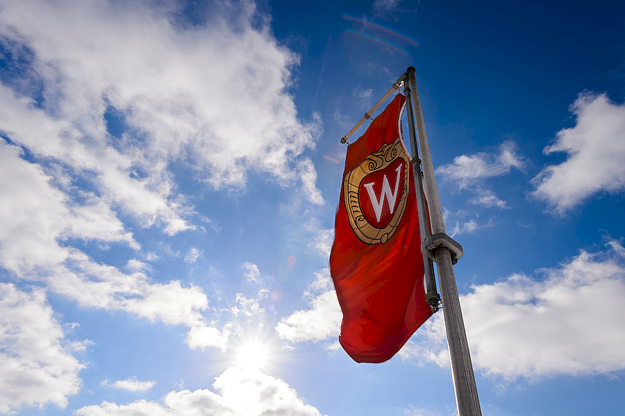 "A picture of ""W"" crest banner waving in the wind."