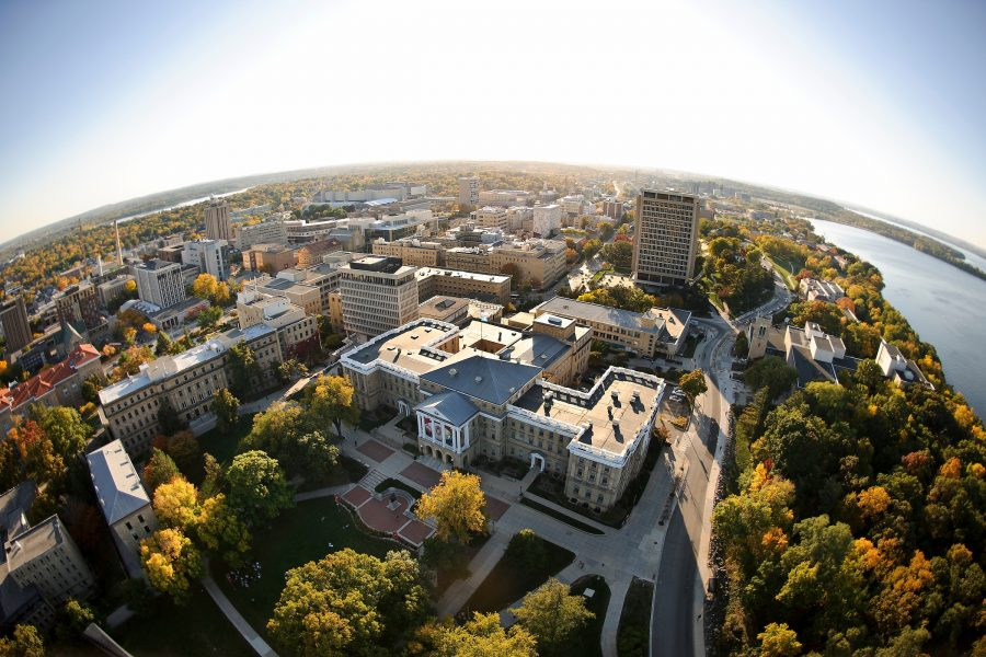 Bascom Hall atop Bascom Hill is pictured in a fisheye-lens aerial view of the University of Wisconsin-Madison campus during an autumn sunset.