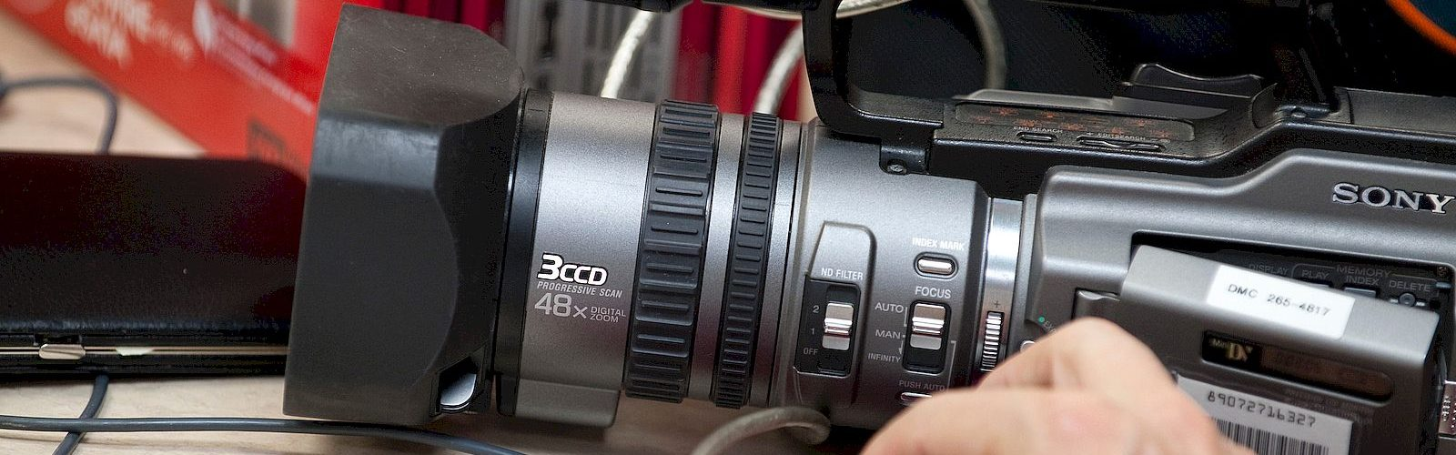 A picture of a video camera on a desk.