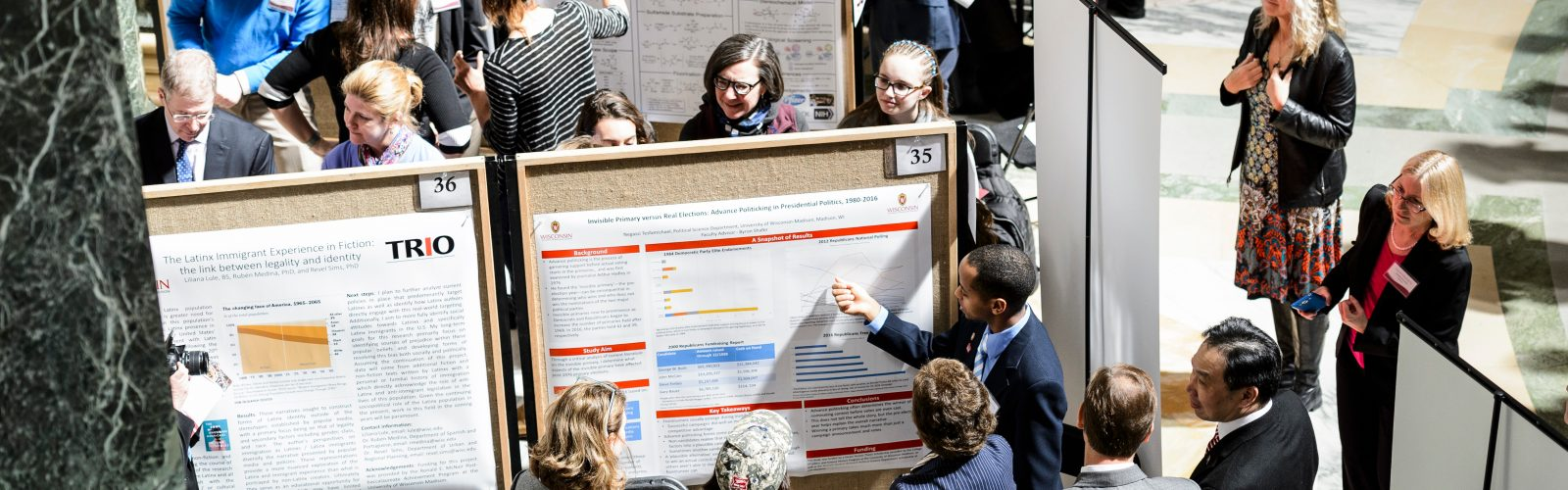 A picture of UW-Madison students presenting their research project displays.