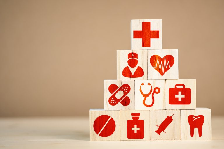 Blocks with red icons representing healthcare